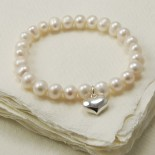 Freshwater pearl stretch bracelet with sterling silver heart charm