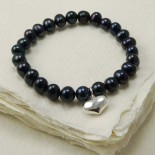Black freshwater pearl bracelet with heart charm