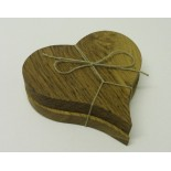 Pair of oak heart shaped coasters