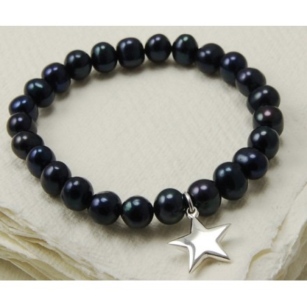 Black freshwater pearl bracelet with silver star charm