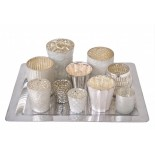 Eclectic tray of 10 various sized milky coloured opaque votives in various sizes tea lights on silver coloured tray