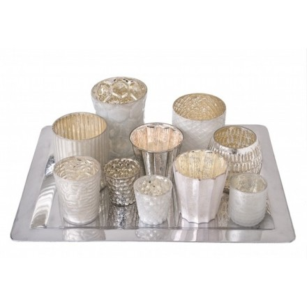 Eclectic tray of 10 various sized milky coloured opaque votives on a silver coloured tray